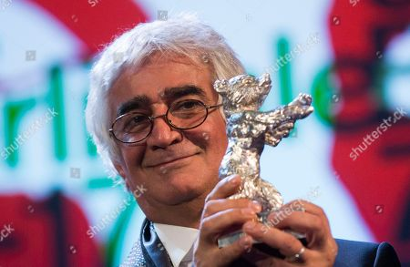 Kambuzia Partovi Director Kambuzia Partovi holds the Silver Bear for Best Script for the film Closed Curtain at the closing ceremony at the 63rd edition of the Berlinale, International Film Festival in Berlin
