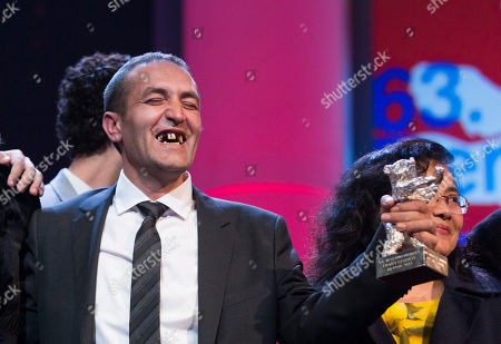 Actor Nazif Mujic with his Silver Bear Best Actor award for his role in An Episode In the Life of an Iron Picker, at the closing ceremony at the 63rd edition of the Berlinale, International Film Festival in Berlin