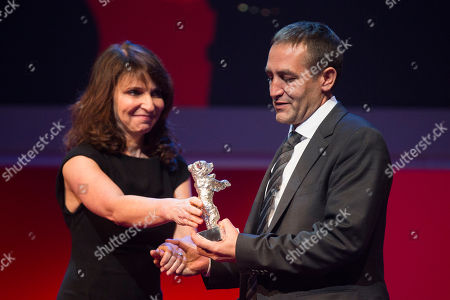 Nazif Mujic, Susanne Bier Actor Nazif Mujic, right, is presented with the Silver Bear Best Actor award for his role in An Episode In the Life of an Iron Picker by director Susanne Bier, at the closing ceremony at the 63rd edition of the Berlinale, International Film Festival in Berlin