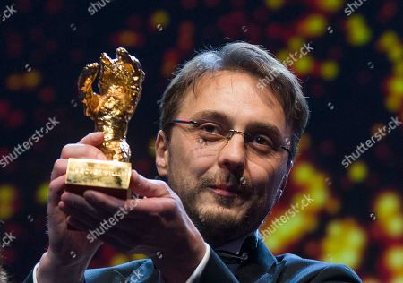 Calin Peter Netzer Director Calin Peter Netzer holds the Golden Bear for his film Child's Pose at the closing ceremony at the 63rd edition of the Berlinale, International Film Festival in Berlin