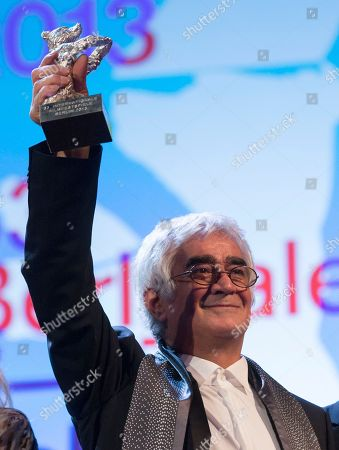 Stock Picture of Kambuzia Partovi Director Kambuzia Partovi holds the Silver Bear for Best Script for the film Closed Curtain at the closing ceremony at the 63rd edition of the Berlinale, International Film Festival in Berlin