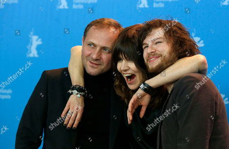 Actor Andrzej Chyra, director Malgoska Szumowska and actor Mateusz Kosciukiewicz pose at the photo call for the film In The Name Of at the 63rd edition of the Berlinale, International Film Festival in Berlin, Friday, Feb.8,2013