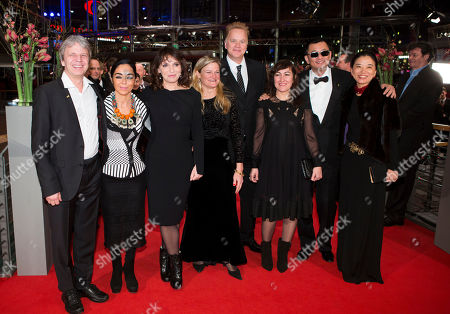 From left, jury members Andreas Kuras, Shirin Neshat, Susanne Bier, Ellen Kuras, Tim Robbins, Athina Rachel Tsangari, jury president Wong Kar Wai and his wife Esther Wong arrive for the opening ceremony at the 63rd edition of the Berlinale, International Film Festival in Berlin, Thursday, Feb.7,2013