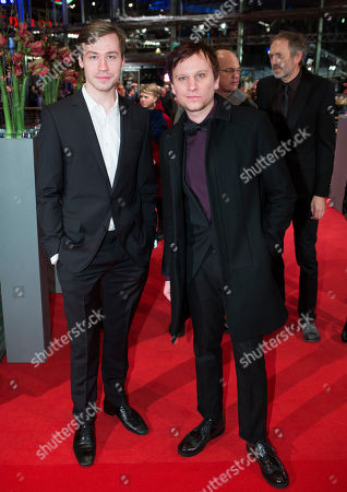 German actors David Kross and Robert Stadlober, right, arrive for the opening ceremony at the 63rd edition of the Berlinale, International Film Festival in Berlin, Germany