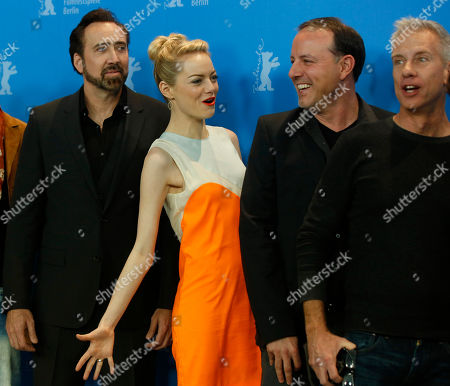Nicholas Cage, Emma Stone, Kirk De Micco, Chris Sanders From left, actors Nicholas Cage, Emma Stone, directors Kirk De Micco and Chris Sanders pose for photographers at the photo call for the film The Croods at the 63rd edition of the Berlinale, International Film Festival in Berlin