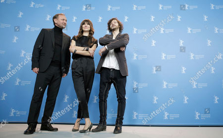 Actor Andrzej Chyra, director Malgoska Szumowska and Mateusz Kosciukiewicz, from left, pose at the photo call for the film In The Name Of at the 63rd edition of the Berlinale, International Film Festival in Berlin, Germany
