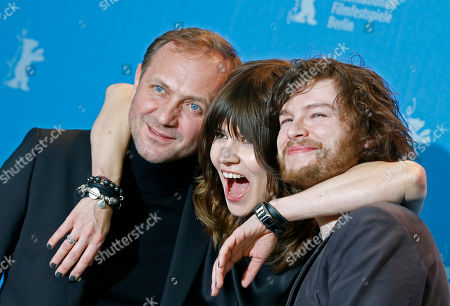 Actor Andrzej Chyra, director Malgoska Szumowska and actor Mateusz Kosciukiewicz, from left, pose at the photo call for the film In The Name Of at the 63rd edition of the Berlinale, International Film Festival in Berlin, Germany