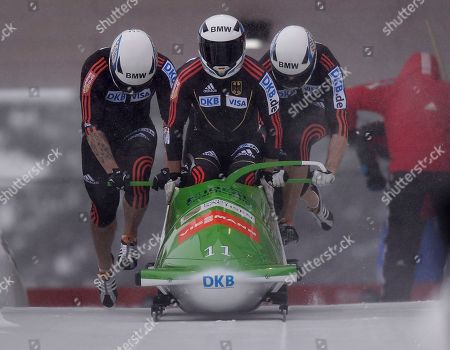 Bob Thomas Florschuetz of Germany leads his team during the start of the 4 Man Bob World Cup race in Winterberg, Germany, . His team Germany 1 finished on the 4th place