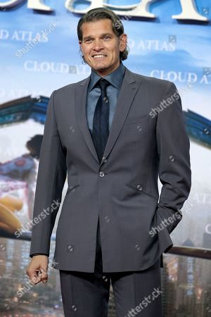 German actor Goetz Otto poses for the media during his arrival for the European premiere of the movie 'Cloud Atlas' in Berlin, Germany