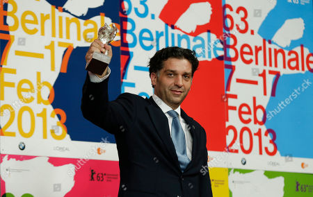 Danis Tanovic Director Danis Tanovic holds his Silver Bear Jury Grand Prix for his film in An Episode In the Life of an Iron Picker as he attends a press conference after the closing ceremony at the 63rd edition of the Berlinale, International Film Festival in Berlin