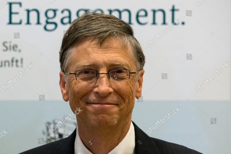 Bill Gates Bill Gates, founder of the software company Microsoft, poses for the media prior to a press conference after a meeting with German Development Aid Minster Dirk Niebel, unseen, in Berlin, Germany, . Slogan in the background reads 'Commitment
