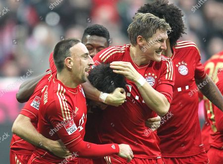 Munichs Franck Ribery, Javi Martinez and Sebastian Schweinsteiger, from Left, celebrate after scoring during the German first division Bundesliga soccer match between Bayern Munich and Hannover 96 in Munich, southern Germany