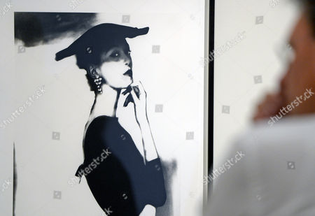 A man stands in front of the photo 'Barbara Mullen' (New York, 1958) of Lillian Bassman in the grand retrospective exhibition 'Two lives for photography' of the American artist couple Lillian Bassman (1917-2012) and Paul Himmel (1914-2009) during a press preview in the Grassi Museum for Applied Arts in Leipzig, central Germany, on . The focal point of the presentation will be Fashion Photography and the experimental aspects of the works of both artists. The artist couple revolutionized photography