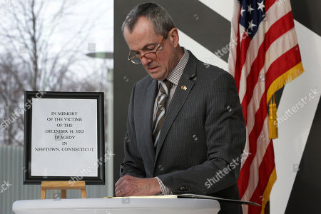Philip D. Murphy US Ambassador in Germany, Philip D. Murphy, writes in a condolence book in Berlin, Germany, for the death of the children and teachers of the Sandy Hook elementary school in Newtown