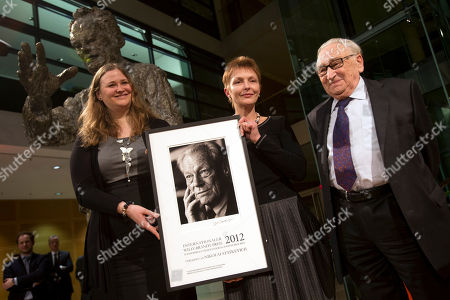 The jury chairman Egon Bahr, right, smiles after he handed over the Willy-Brandt-Prize to Marina Statkevich, center, the wife of the prize winner and politician in Belarus, Nikolai Statkevich, and his daughter Katja Statkevich, left, during a reception at the headquarter of the German Social Democratic party (SPD) in Berlin, Germany, . Nikolai Statkevich himself is arrested in Belarus