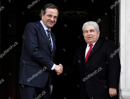 Antonis Samaras, Dimitris Christofias Greek Prime Minister Antonis Samaras, left, shakes hands with the President of Cyprus Dimitris Christofias, in Athens, on . Christofias, is in Greece on his last official visit as President of the Republic days before the upcoming presidential election in Cyprus