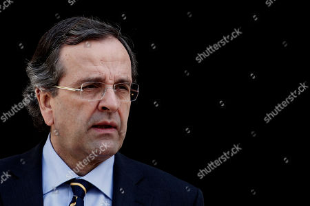 Antonis Samaras Greek Prime Minister Antonis Samaras, waits the arrival of President of Cyprus Dimitris Christofias, in Athens, on . Greece battles a sixth year of recession and high unemployment from austerity measures in exchange for ongoing rescue loans from International Monetary Fund and the other 16 European Union countries that use the euro