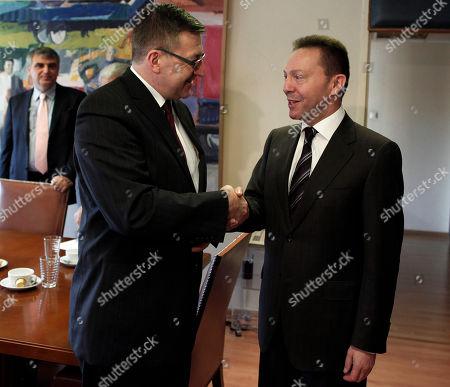 Yannis Stournaras, Steven Vanackere Greek Finance Ministrer Yannis Stournaras, right, shakes hands with his Belgian counterpart Steven Vanackere at the Ministry of Finance, in Athens
