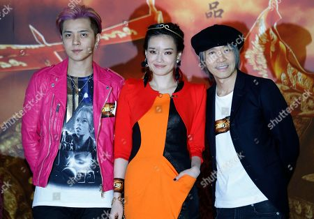 """Shu Qi, Stephen Chow, Show Luo From left to right., Taiwanese actor Show Luo, actress Shu Qi and Hong Kong director Stephen Chow react during a press conference for their new film """"A Chinese Odyssey"""" in Hong Kong"""