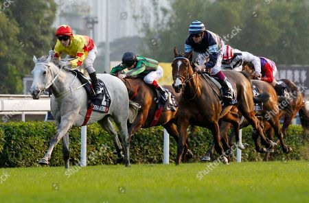 Matthew Chadwick, California Memory Hong Kong jockey Matthew Chadwick, riding Hong Kong horse California Memory, left, competes on his way to win the 2,000-meter Longines Hong Kong Cup horse race at the Shatin race track, followed by French horse Giogra, right, in Hong Kong