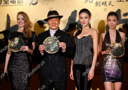 """Laure Weissbecker, Jackie Chan, Zhang Lanxin, Yao Xingtong From left, French actress Laure Weissbecker, Hong Kong movie star Jackie Chan, Chinese actresses Zhang Lanxin and Yao Xingtong pose for photographers during the charity premiere of his new movie """"CZ12"""" in Hong Kong, . Jackie Chan suggests in a recent interview that protests should be restricted in the freewheeling Chinese city of Hong Kong. The action star lamented that Hong Kong has become a city of protest, where people """"scold China, scold the leaders, scold anything, protest against anything"""