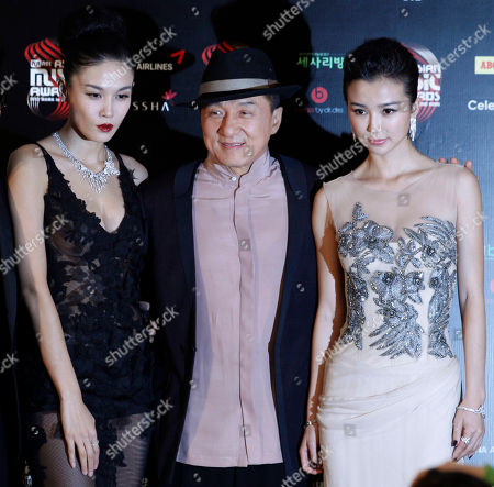 Jackie Chan, Yao Xingtong, Zhang Lan Xin Hong Kong movie star Jackie Chan, center, poses with two Mainland Chinese actresses Yao Xingtong, right and Zhang Lan Xin for photographers at a news conference of the Mnet Asian Music Awards (MAMA) in Hong Kong . The MAMA is one of the major K-pop music award ceremonies