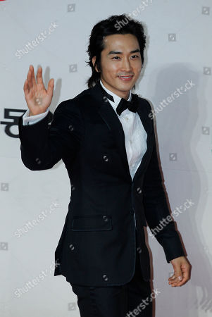 Song Seung-heon South Korean actor Song Seung-heon poses for photographers on the red carpet of 2012 Mnet Asian Music Awards (MAMA) in Hong Kong . The MAMA is one of the major K-pop music award ceremonies