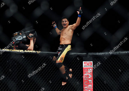 "Cung Le Cung Le of Vietnam reacts after winning the middleweight match, of the Ultimate Fighting Championship UFC, after beating Rich ""Ace"" Franklin of the US, at the Venetian Macao, in Macau . Cung Le won by a knock out in the first round"