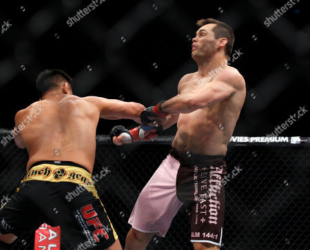 "Rich ""Ace"" Franklin, Cung Le Rich ""Ace"" Franklin of the US, right is hit by Cung Le of Vietnam, during their Middleweight match, of the Ultimate Fighting Championship UFC, at the Venetian Macao, in Macau, . Cung Le won by a knock out in the first round"