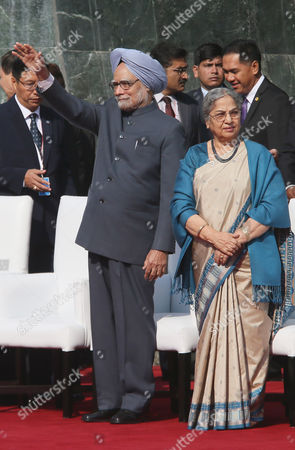 Manmohan Singh, Gursharan Kaur Indian Prime Minister Manmohan Singh with his wife Gursharan Kaur waves during the flag down ceremony of an Association of Southeast Asian Nations (ASEAN) Car rally, in New Delhi, India, . The car rally which was organized to commemorate the 20 years of ASEAN-India relationship was flagged off from Yogyakarta in Indonesia on Nov. 26 in which 31 sports utility vehicles and 124 participants from 9 nations, travelled a distance of around 8,000 kilometers (5000 miles) passed through Singapore, Malaysia, Thailand, Cambodia, Laos and Myanmar before ending the journey in India