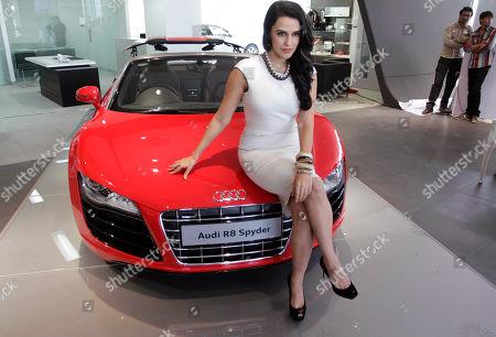 Neha Dhupia Bollywood actress Neha Dhupia poses with an Audi R8 Spyder car during the inauguration of an Audi showroom in Ahmadabad, India
