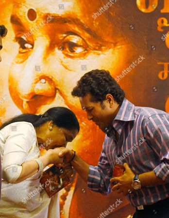 Sachin Tendulkar, Asha Bhosle Indian Bollywood playback singer Asha Bhosle, left, greets Indian cricketer Sachin Tendulkar during the Music launch of Bhosle's film ëMaií in Mumbai, India, . 79 year old Bhosle is making her acting debut in this film
