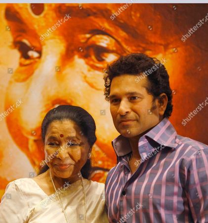 Sachin Tendulkar, Asha Bhosle Indian cricketer Sachin Tendulkar right, poses for the media with Indian Bollywood playback singer Asha Bhosle during the Music launch of Bhosleís film ëMaií in Mumbai, India, . 79 year old Bhosle is making her acting debut in this film