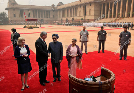 Manmohan Singh, Stephen Harper, Laureen Harper, Gursharan Kaur Indian Prime Minister Manmohan Singh, second right, shakes hand with his Canadian counterpart Stephen Harper as Harper's wife Laureen, left, and Singh's wife Gursharan Kaur, right, look on during a ceremonial reception at the Indian presidential palace in New Delhi, India, . Harper is on a five-day visit to India