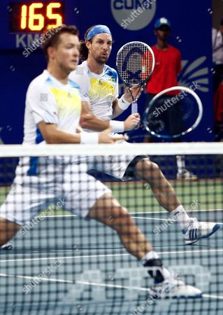 Andre Begemann, Martin Emmrich Germany's Andre Begemann, right, and Martin Emmrich plays against Switzerland's Stanislas Wawrinka and Benoît Paire of France during their doubles final match of the ATP Chennai Open tennis tournament in Chennai, India