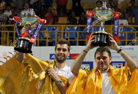 Stanislas Wawrinka, Benoît Paire Switzerland's Stanislas Wawrinka, right, and Benoît Paire of France hold up their winner's trophy after the doubles final match against Germany's Andre Begemann and Martin Emmrich at the ATP Chennai Open tennis tournament in Chennai, India
