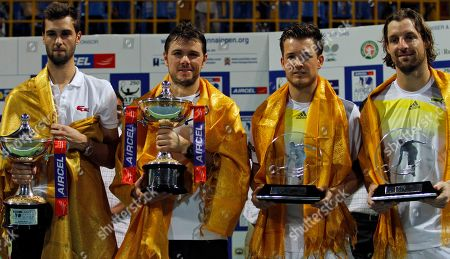 Stanislas Wawrinka, Benoît Paire, Andre Begemann, Martin Emmrich Switzerland's Stanislas Wawrinka, second left, and Benoît Paire of France, left, hold their winner's trophy after the doubles final match against Germany's Andre Begemann, right, and Martin Emmrich, second right, at the ATP Chennai Open tennis tournament in Chennai, India