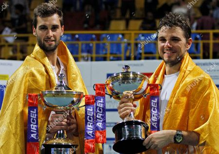 Stanislas Wawrinka, Benoît Paire Switzerland's Stanislas Wawrinka, right, and Benoît Paire of France celebrate holding their winner's trophy after the doubles final match against Germany's Andre Begemann and Martin Emmrich at the ATP Chennai Open tennis tournament in Chennai, India