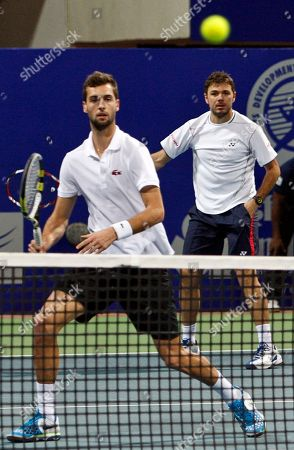 Stanislas Wawrinka, Benoît Paire Switzerland's Stanislas Wawrinka, right, and Benoît Paire of France, left, play the doubles final match against Germany's Andre Begemann and Martin Emmrich at the ATP Chennai Open tennis tournament in Chennai, India