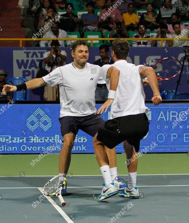Stanislas Wawrinka, Benoît Paire Switzerland's Stanislas Wawrinka, left, and Benoît Paire of France celebrate after winning the doubles final match against Germany's Andre Begemann and Martin Emmrich at the ATP Chennai Open tennis tournament in Chennai, India