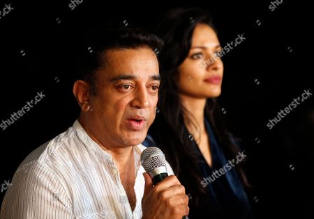 """Kamal Hassan Kamal Hassan, one of the biggest movie stars in southern India, left, speaks as actress Pooja Kumar listens during a news conference in Mumbai, India, . Hassan said Thursday he would go ahead with the release of a Hindi language version of his controversial spy thriller """"Vishwaroopam"""" as he fights a court battle for the release of the Tamil language version in his home state of Tamil Nadu. Several Muslim groups protested the film's release in Tamil Nadu, objecting to its portrayal of Islam"""