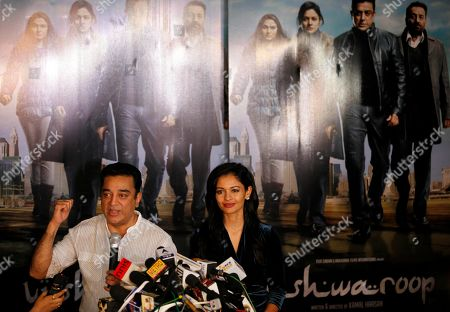 """Kamal Hassan Kamal Hassan, one of the biggest movie stars in southern India, left, speaks as actress Pooja Kumar listens during a press conference in Mumbai, India, . Hassan said Thursday he would go ahead with the release of a Hindi language version of his controversial spy thriller """"Vishwaroopam"""" as he fights a court battle for the release of the Tamil language version in his home state of Tamil Nadu. Several Muslim groups protested the film's release in Tamil Nadu, objecting to its portrayal of Islam"""