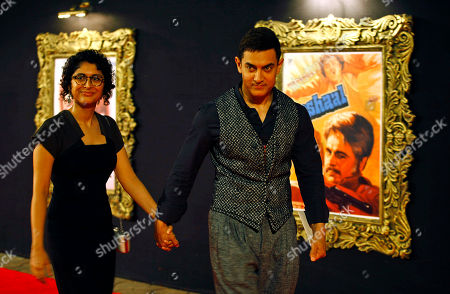 """Aamir Khan, Kiran Rao Bollywood star Aamir Khan arrives with his wife Kiran Rao to attend the premiere of the film """"Jab Tak Hai Jaan"""" or """"As Long As I Am Alive"""" in Mumbai, India. Bollywood stars turned out in strength at the premiere of the movie for a final homage to movie mogul Yash Chopra, who died last month days after finishing the film. Chopra was known as the """"King of Romance"""" for creating classic love stories that were immensely popular"""
