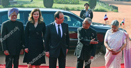 Francois Hollande, Pranab Mukherjee, Manmohan Singh,Valerie Trierweiler, Gursharan Kaur French President Francois Hollande, center, watches as Indian President Pranab Mukherjee, second from right, introduces Indian Prime Minister Manmohan Singh's wife Gursharan Kaur, right, during a ceremonial reception in honor of Hollande, at the presidential palace in New Delhi, India, . Also seen are Indian Prime Minister Manmohan Singh, left, and Hollande's partner,Valerie Trierweiler, second from left. Hollande is on a two-day visit to India
