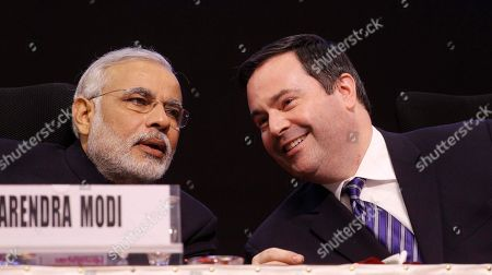 Narendra Modi, Jason Kenney Gujarat state chief minister Narendra Modi speaks with Canadian Minister of Citizenship, Immigration and Multiculturalism, Jason Kenney, during the 6th Vibrant Gujarat Global Summit (VGGS) in Gandhinagar, India, . Vibrant Gujarat Global Summit is a biennial gathering on emerging business opportunities in Gujarat and beyond