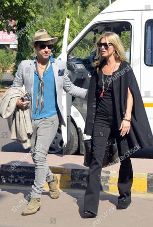 Stock Image of Kate Moss, Jamie Hince Supermodel Kate Moss walks with her boyfriend Jamie Hince as they leave after the birthday celebrations of Russian billionaire Vladimir Doronin, who is also the boyfriend of supermodel Naomi Campbell, in Jodhpur, in the western Indian state of Rajasthan. Campbell's spokeswoman said that the celebration of Doronin's 50th birthday kicked off in the 15th century Mehrangarh Fort in the city of Jodhpur on Tuesday night. The festivities included fireworks, traditional music and dancing and an elaborate buffet meal