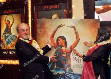 Salman Rushdie, Deepa Mehta Author Salman Rushdie, left, and director Deepa Mehta pose for the media before a screening of 'Midnight Children' at a movie hall in New Delhi, India, Tuesday, Jan.22, 2013. Rushdie is in India on a promotional tour for Deepa Mehtaës Midnightís Children, based on his Booker Prize-winning novel of the same name