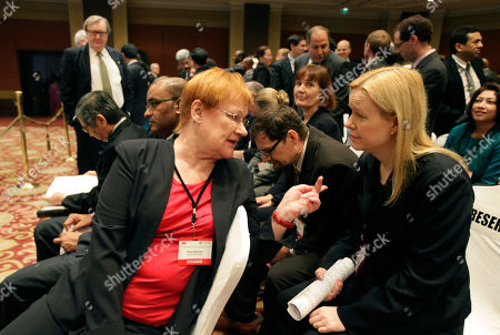 Tarja Halonen Former President of Finland Tarja Halonen, left, talks to a delegate during the 13th Delhi Sustainable Development Summit, in New Delhi, India, . The event is organized by the Energy and Resources Institute (TERI