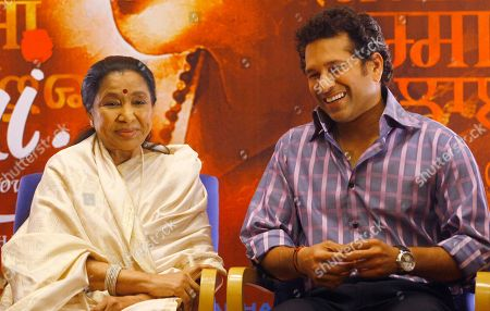Indian cricketer Sachin Tendulkar right, shares a light moment with Indian singer Asha Bhosle during a 'Mai' (Mother) music launch in Mumbai, India