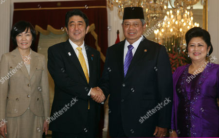 Shinzo Abe, Susilo Bambang Yudhoyono Japan's Prime Minister Shinzo Abe, second left, his wife Akie, left, pose for photos with Indonesia's President Susilo Bambang Yudhoyono, second right, and his wife Ani Bambang Yudhoyono before a meeting at Merdeka Palace in Jakarta, Indonesia